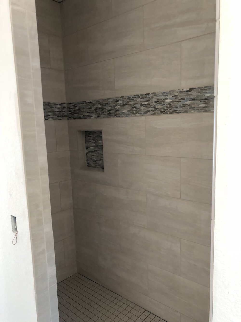 Recently completed tile work in the shower/master bath