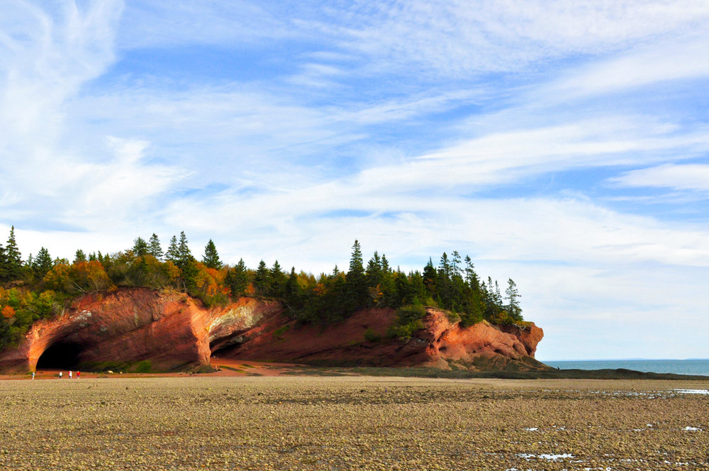The Bay of Fundy Sea Caves are a sight worth driving out of your way for, and taking the time to sit and watch the tide pass. They are a UNESCO World Heritage Site, and for scale the red dots on the left are people.