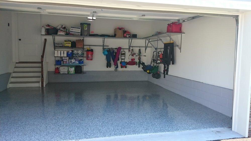 Garage concrete floor with polyurea / epoxy coating and shelves with under-shelf adjustable rack storage example