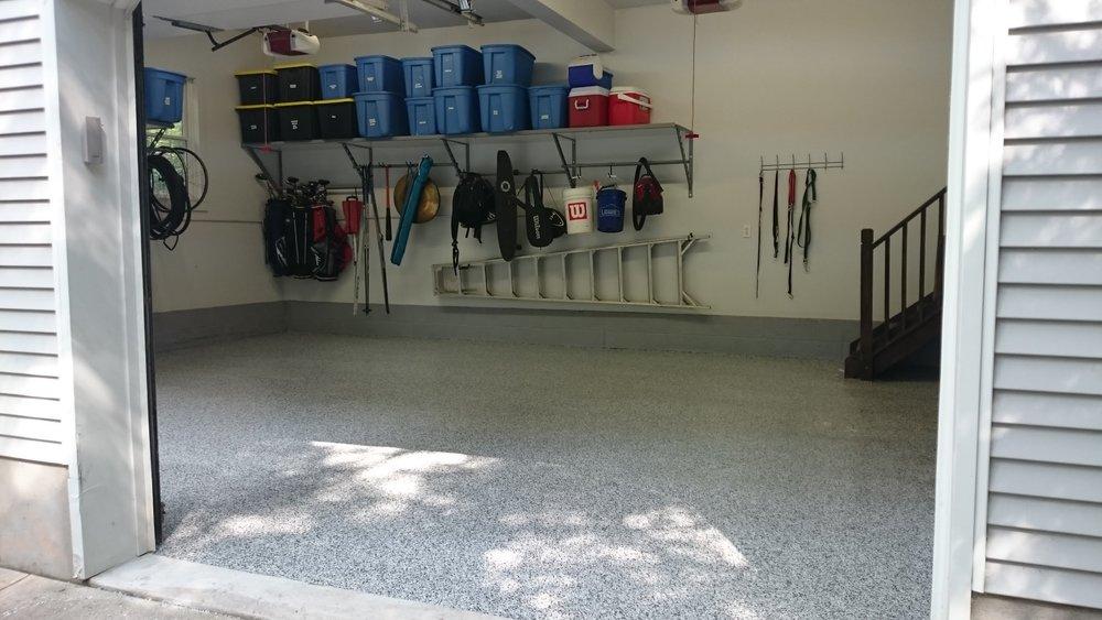 Garage concrete floor with polyurea / epoxy coating with garage shelves with under-shelf adjustable rack storage example