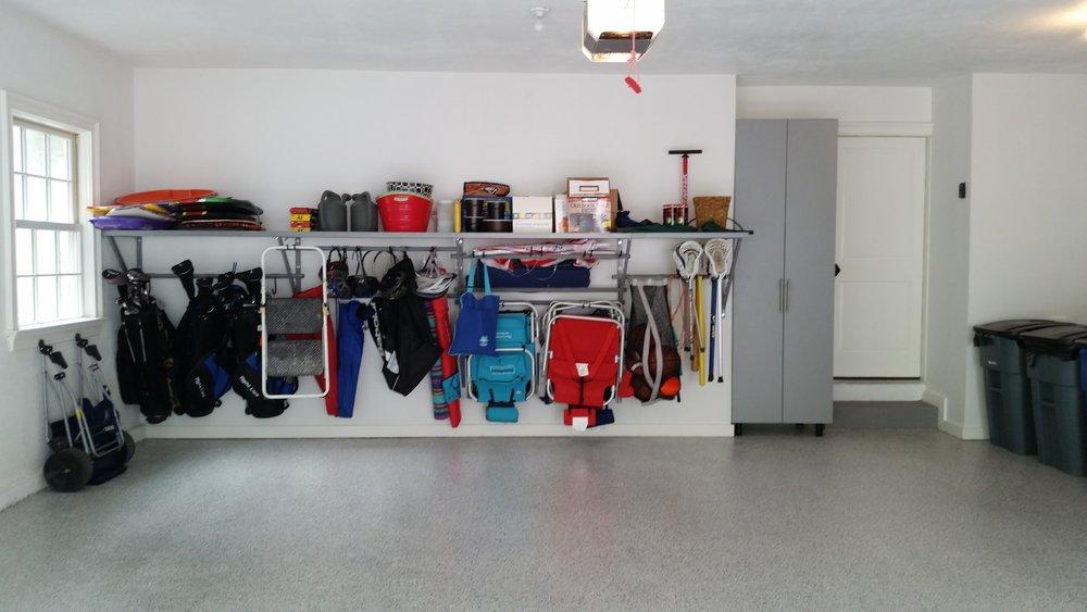Garage concrete floor with polyurea / epoxy coating with garage shelves and garage storage cabinets example