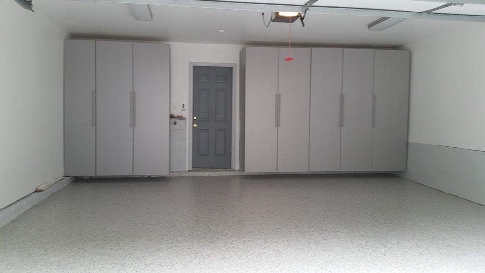 Garage concrete floor with polyurea / epoxy coating with matching garage storage cabinets example