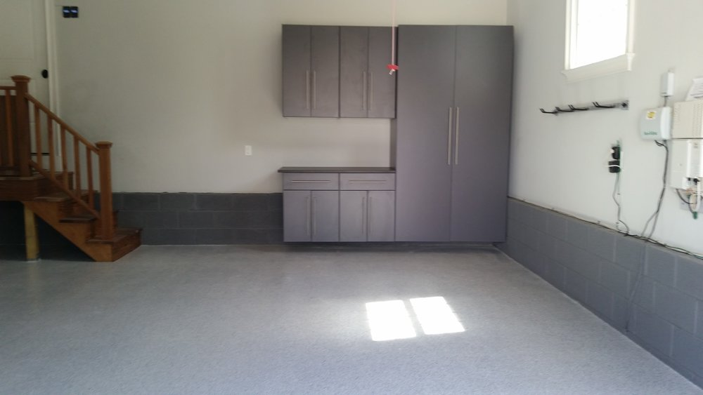 Garage concrete floor with polyurea / epoxy coating with garage storage cabinets with work bench example