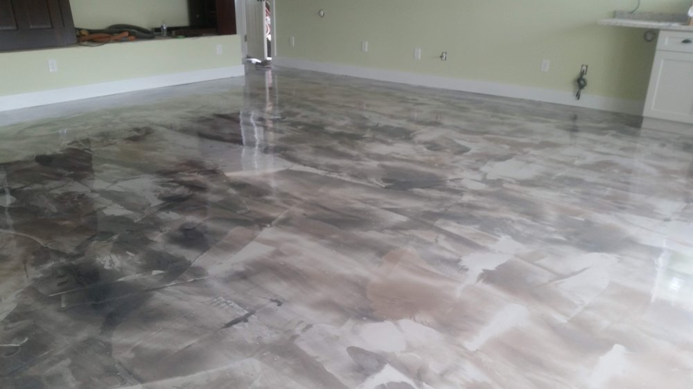 Decorative concrete floor coating for homes with metallic marble texture example