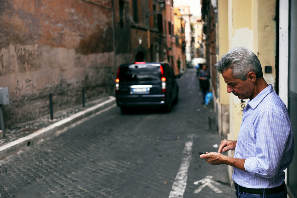 Man on phone in Rome