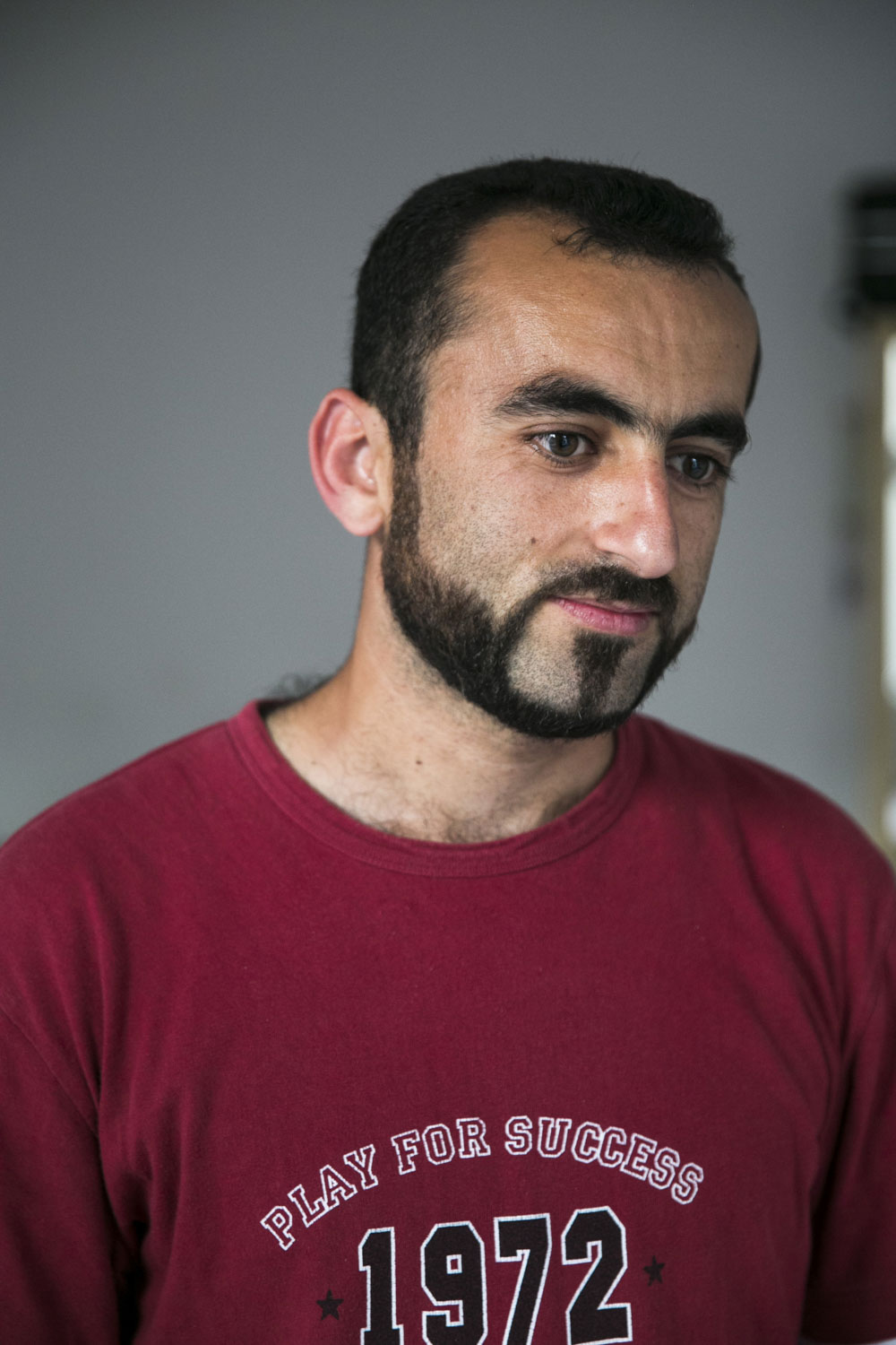 Bashar in his flat in Kreuzberg, 2016.