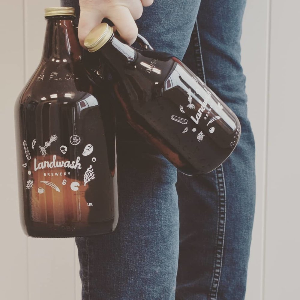 GROWLER POLICY - We sell our growlers in both sizes (0.95L and 1.89L, we just call them big and small growlers here). Our growler price is not a deposit on the glass it is a final sale and we do not take growlers back for a refund. Once you buy it, you own it and you can take the very best care of it for a long life of use. Because we only sell growlers, we will fill any growler with a marked volume that conforms to the two sizes we have approved pricing for from the NLC (the Newfoundland Liquor Corporation). We reserve the right to refuse to fill a growler that isn't clean to our standards (as listed on our growler, rinse the growler with warm water once it's empty and let it dry without the lid which is disposable and will be replaced next fill). Before we fill your growler we will rinse it with cold water and fill it with the beer of your choosing. Be sure to check out availability as not all beers sold at the taproom are always available for growler fills. Due to concerns with filling we do not currently fill or service GrowlerWerks growlers.