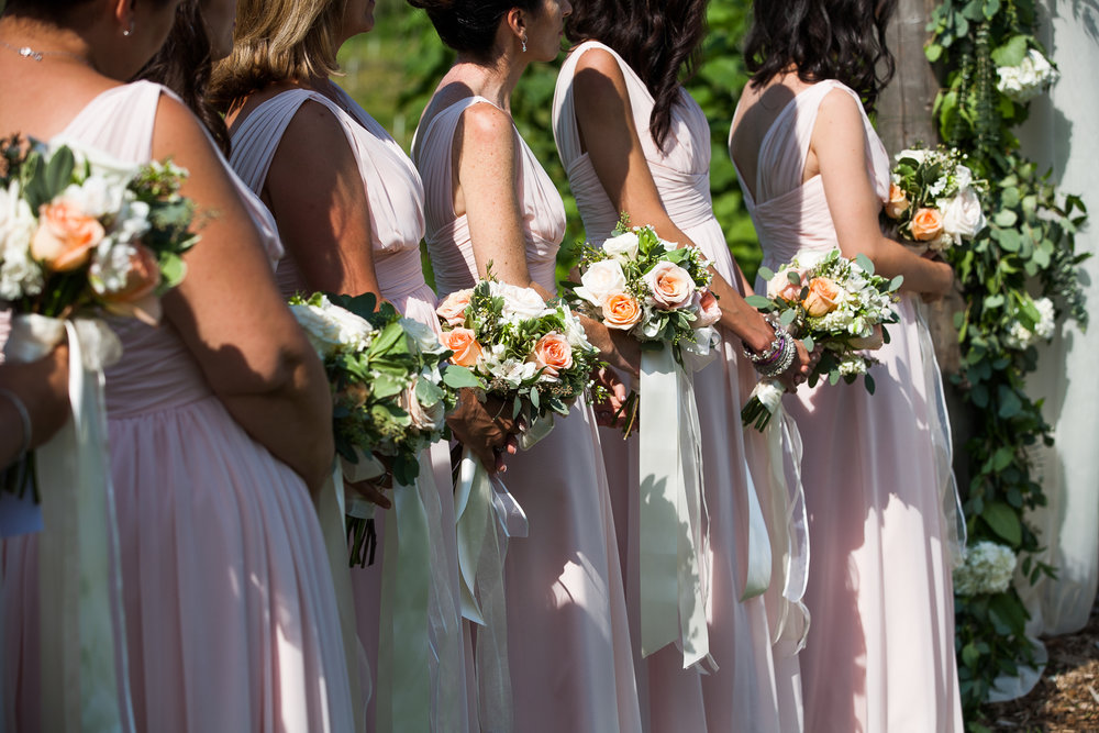 Light pink bridesmaids garden wedding