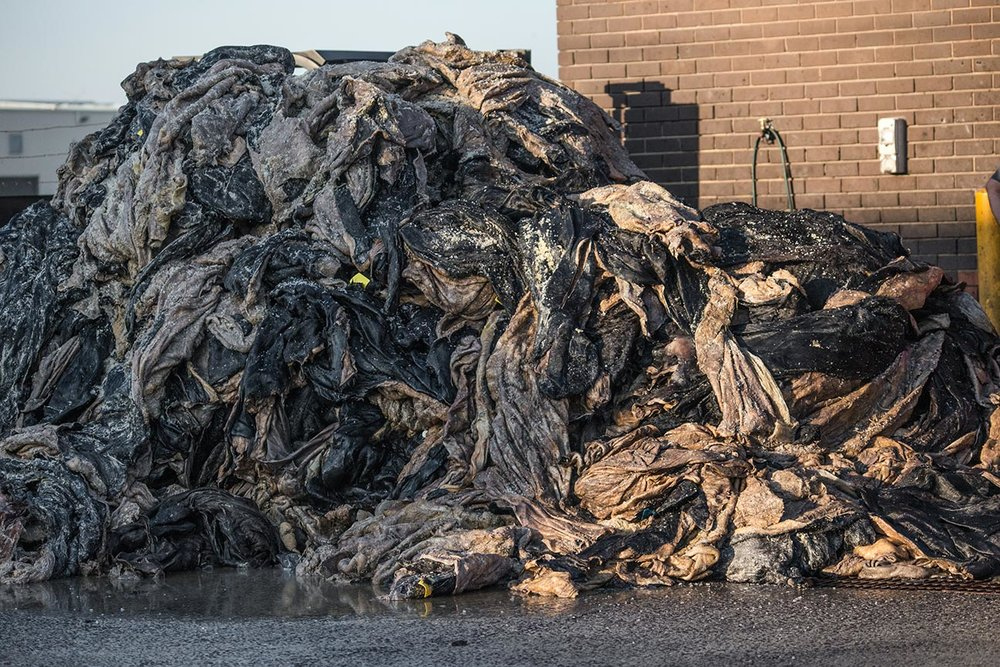 Huge stack of piled sheep and cow skins. Australia, 2017. Copyright  Jo-Anne McArthur / We Animals .