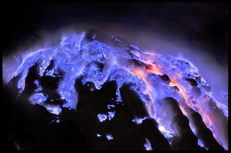 Stunning Electric-Blue Flames Erupt From Volcanoes - PHOTOGRAPH BY OLIVIER GRUNEWALDIndonesia's Kawah Ijen and other craters emit rivers of light from burning sulfur.BY BRIAN CLARK HOWARD, NATIONAL GEOGRAPHICPUBLISHED JANUARY 30, 2014For several years Paris-based photographer Olivier Grunewald has been documenting the Kawah Ijen volcano in Indonesia, where dazzling, electric-blue fire can often be seen streaming down the mountain at night.