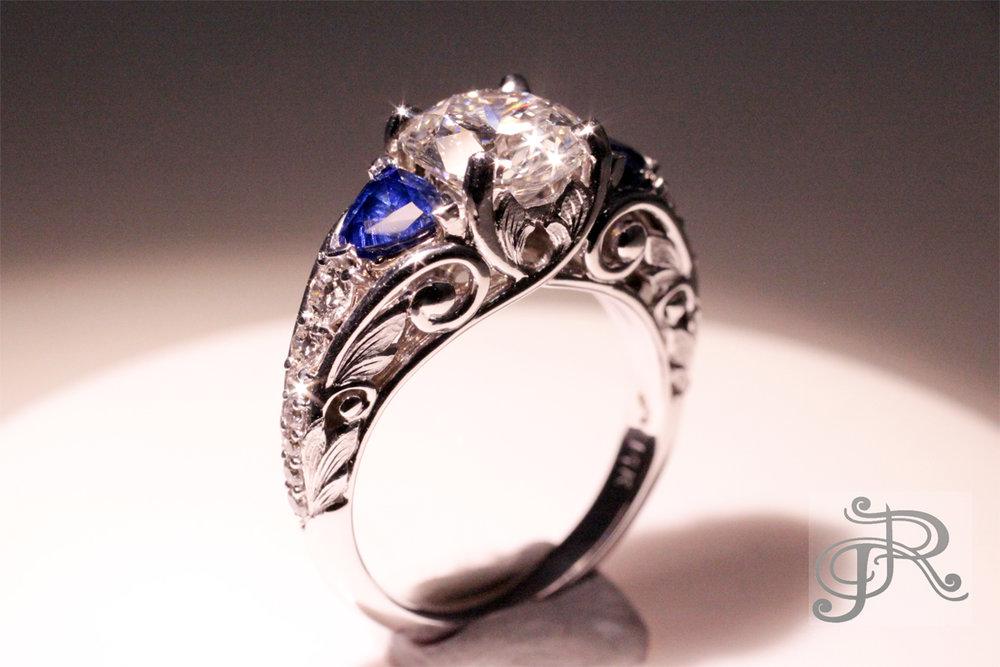1.75 ct Diamond, large Sapphires and 14 accent Diamonds