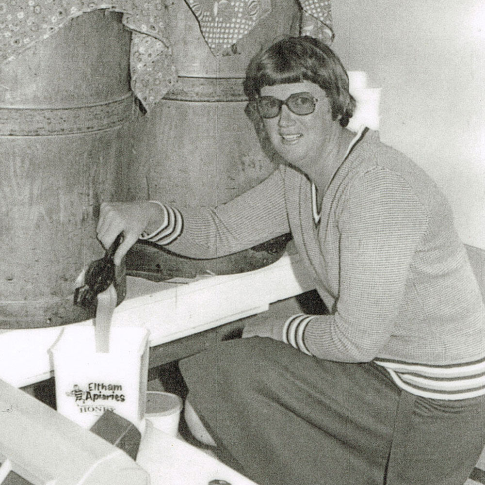 Gay Rowe packing honey from the first honey vat.