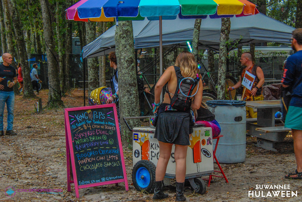 King of Pops serving a customer at Suwannee Hulaween 2018 in front of the Amphitheater stage.