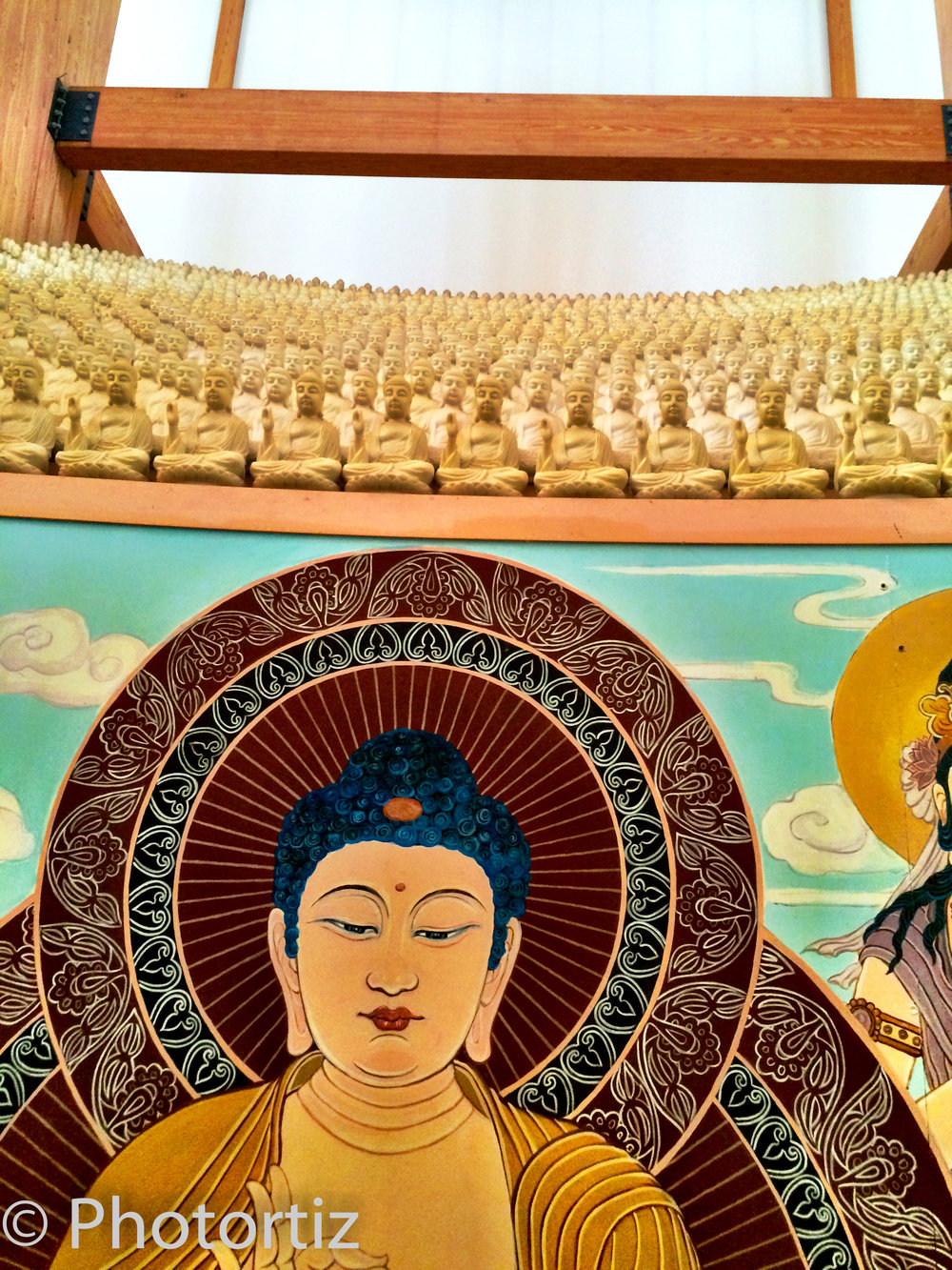 Hundreds of miniature Buddhas surround the big statue.