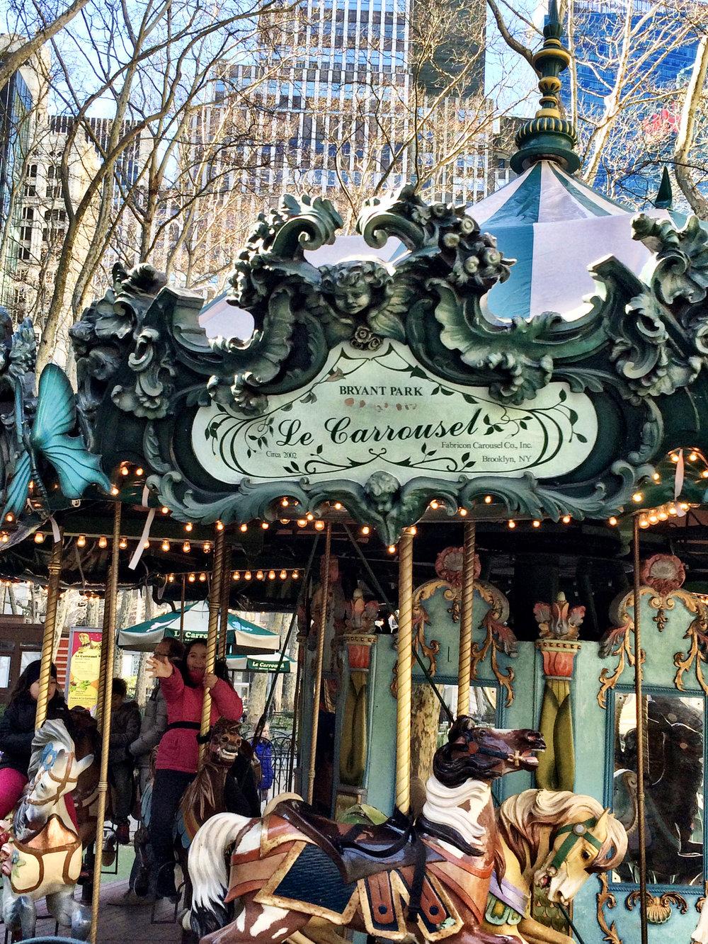 Happy girl in the carrousel.