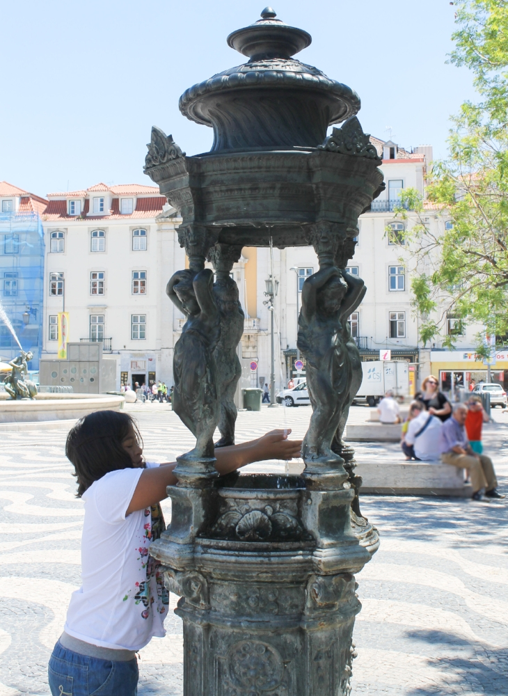 It's not everyday that she drinks water out of a XVIII century fountain.