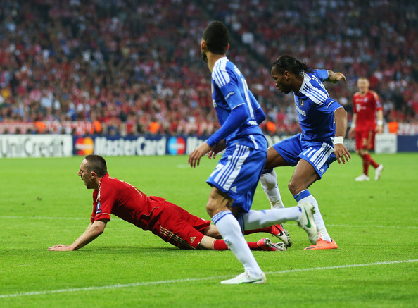 Drogba commits a foul on Ribery just 4 minutes into extra time.