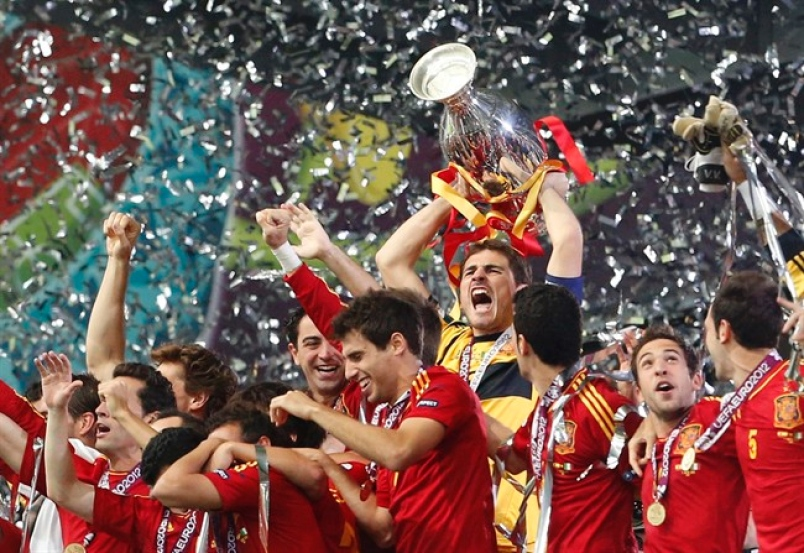 Casillas celebrates Spain's third trophy in three consecutive tournaments.
