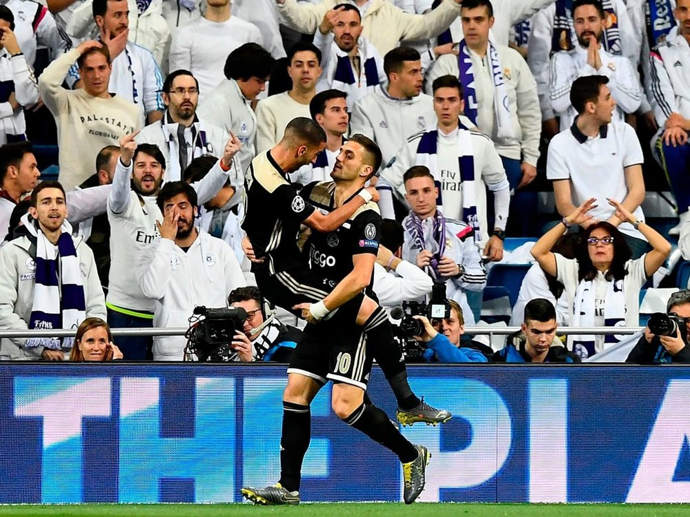 Dusan Tadic (right) stole the show at the Bernabeu with a goal and two assists.