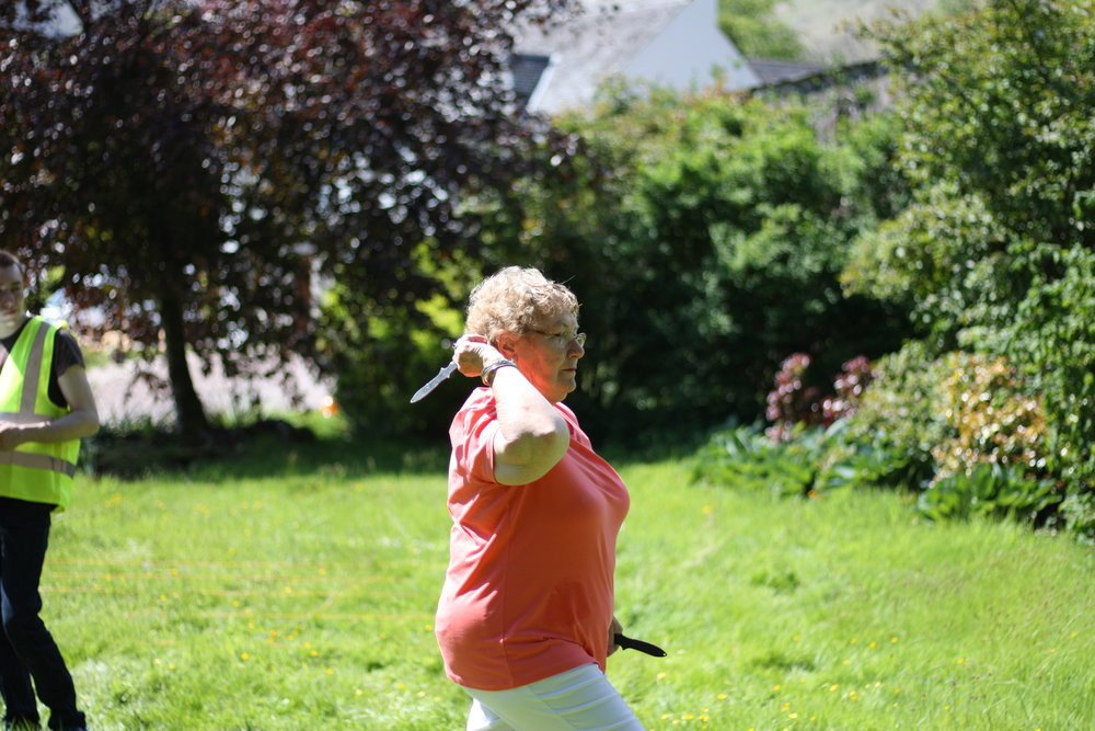 Let's acknowledge how amazing Megan's grandma Janice MacNeill is -- casually throwing knives like a pro, giving her sons throwing advice.
