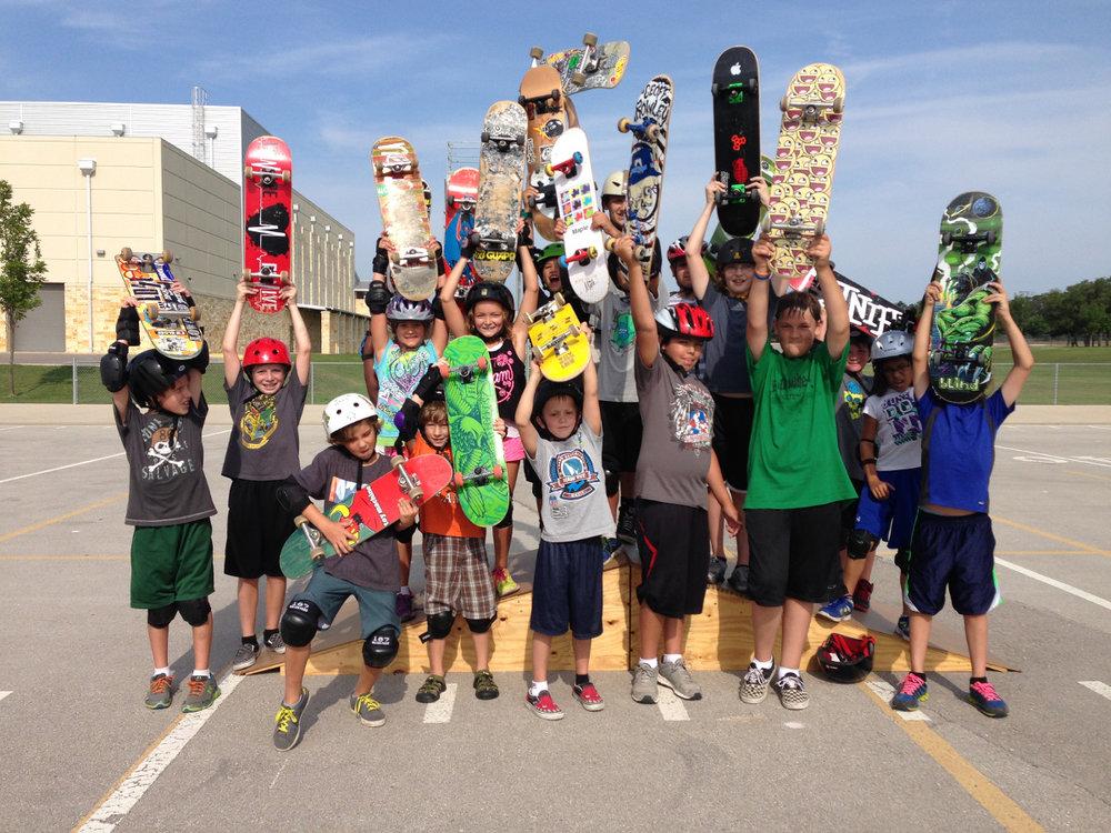 summer_kids_holding_boards_up.jpg