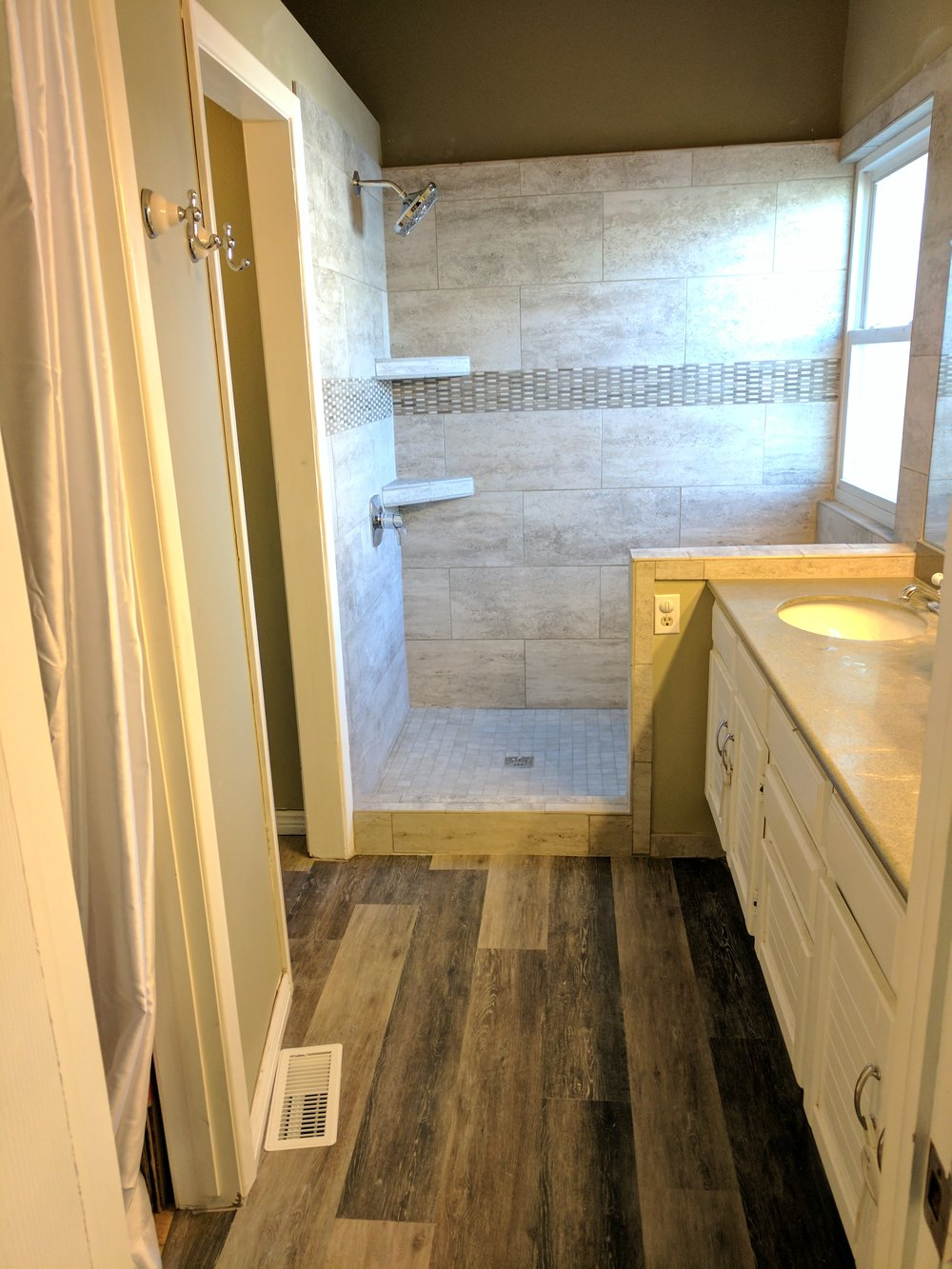 Photos were not used for MLS.  This was a consult for bathroom remodel before the house was listed.  I dressed the entry a bit, as there was nothing but a No Soliciting sign