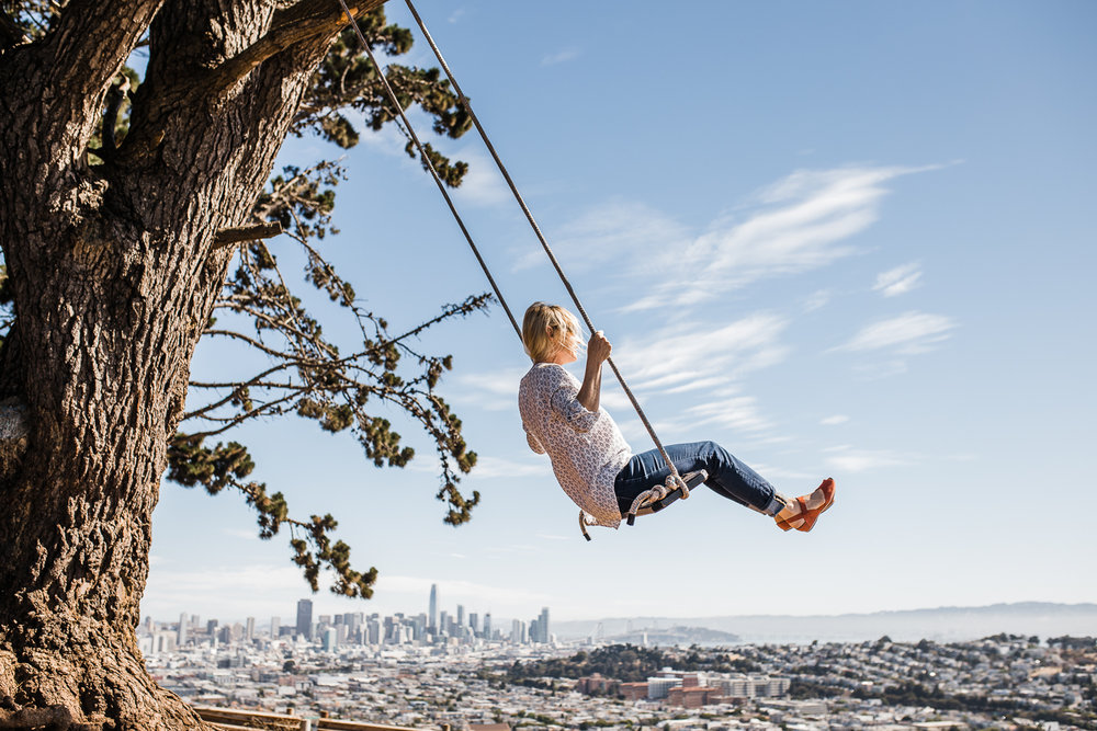 Mom swinging with a view overlooking the city {San Francisco Lifestyle Family Photographer}
