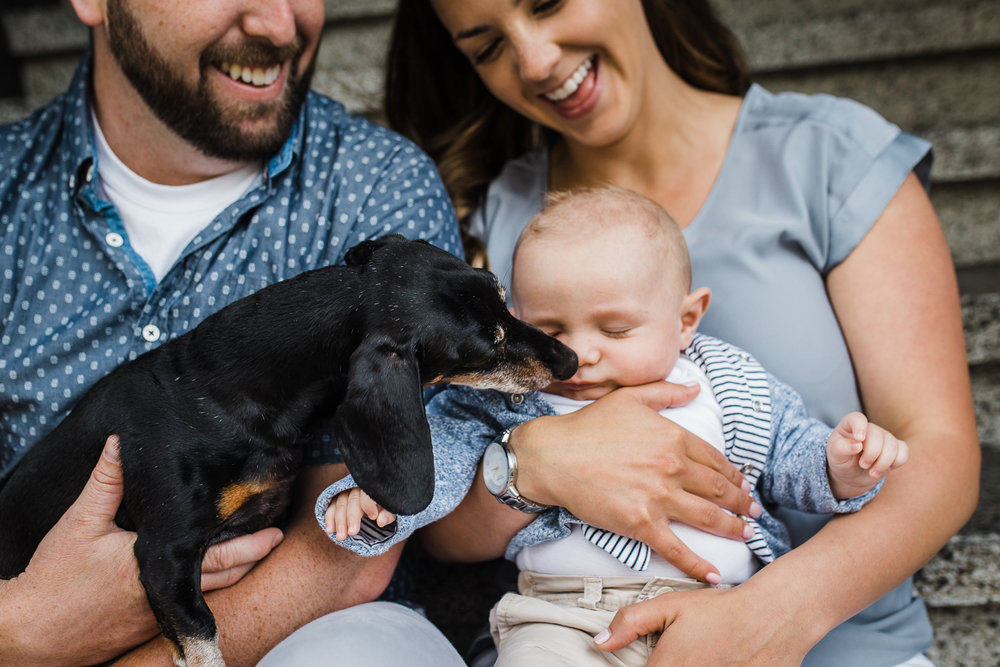 Family photo with dog kissing the newborn baby boy {San Francisco in-home newborn photographer}