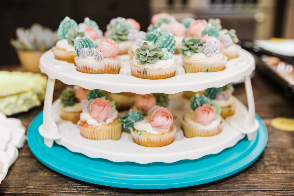 a two-tier tray of cupcakes at a gender reveal party {San Francisco Family Photographer}
