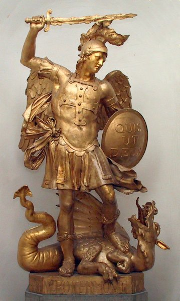 This statue of Archangel Michael includes the Latin translation of his name on his shield.