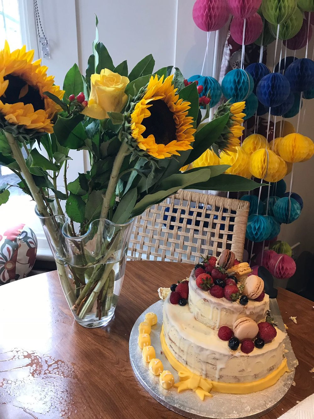 A delicious lemon and elderflower cake and a bunch of sunflowers. Gorgeous!