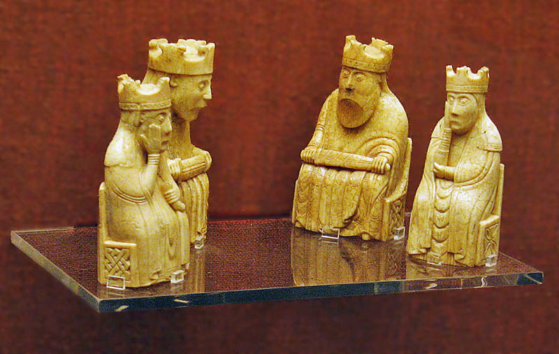 The Lewis chess pieces look like ruler and his council talking things through.