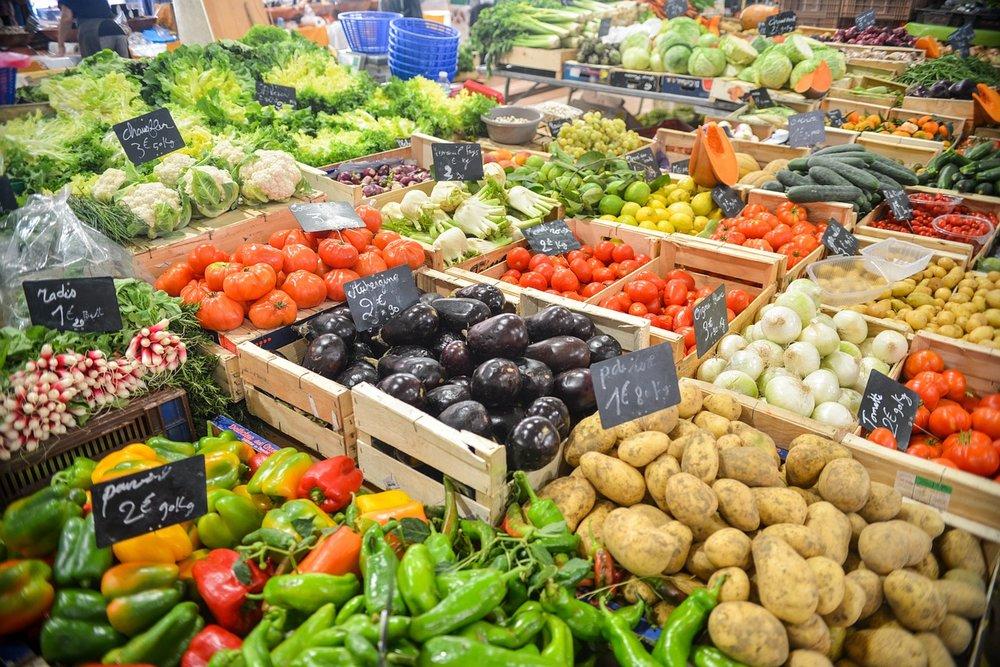 An abundance of vegetables on a market stall.