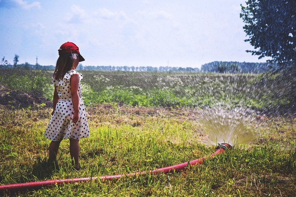 Girl irrigating the farm.