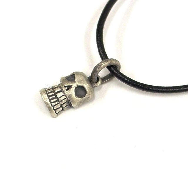 Grinning Skull Pendant, 100% sterling silver $49.95 available in bronze $27.95 Can be made as a key ring or necklace! #skulljewelry #gothjewelry #spooky #madeindetroit #skulls #sterlingsilver #jewelrydesigner #familybusiness #rockstarjewelry