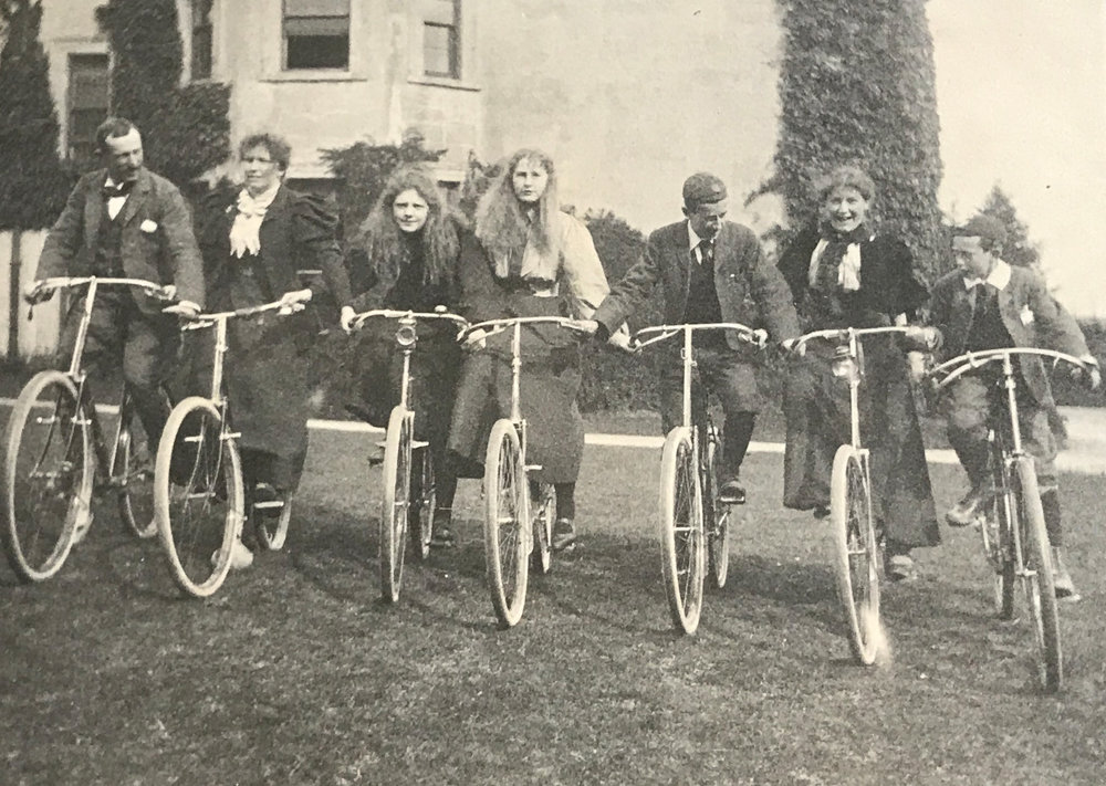 Lady Rhondda is seen here at her maternal grandfather's house on a bike ride with other family members. She is the figure 3rd from left hunched over her bicycle.