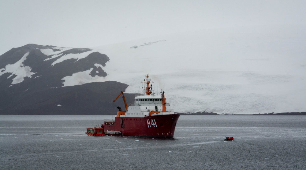 View of the polar ship Admiral Maximiano with the King George Island on the background.