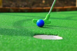 A-blue-mini-golf-ball-and-a-green-club.jpg