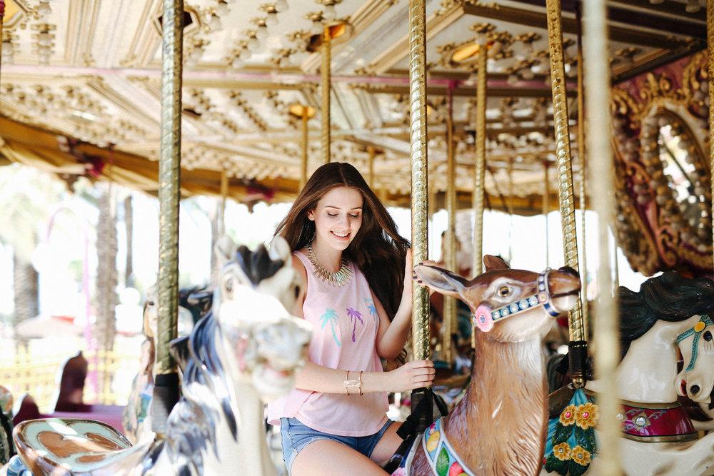 Woman riding the carousel
