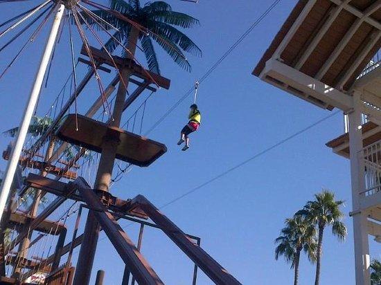 A man enjoying the zip line attraction.