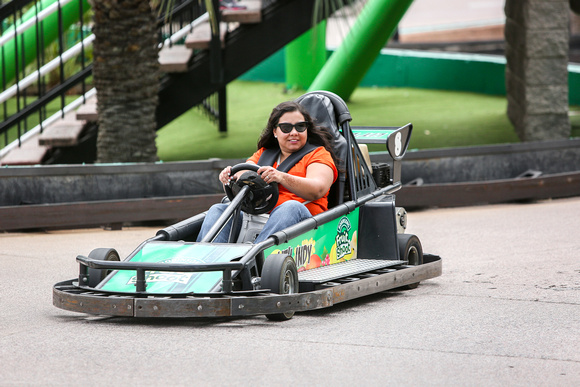 A woman racing on the Go Karts.