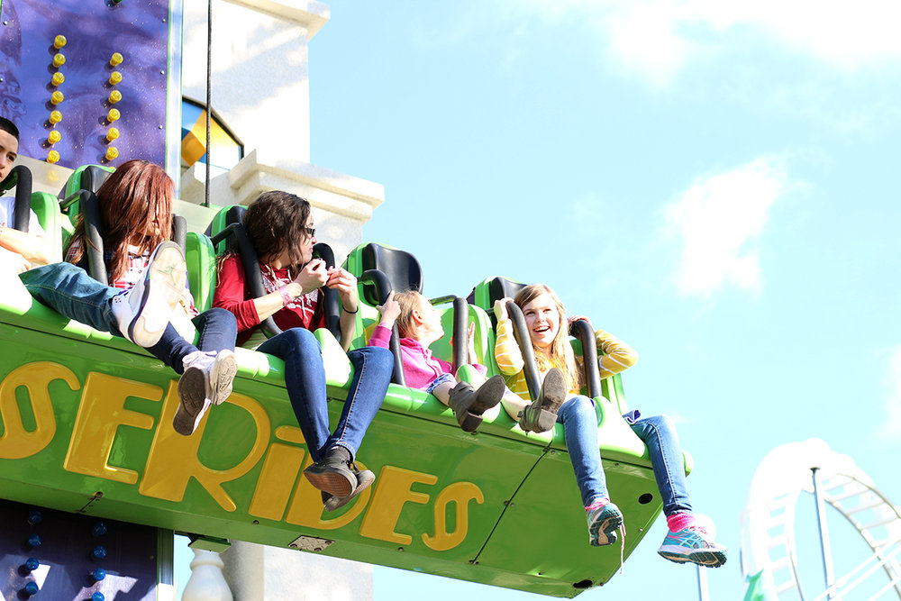 Photo of children having a great time gliding through the air on Free Fall.
