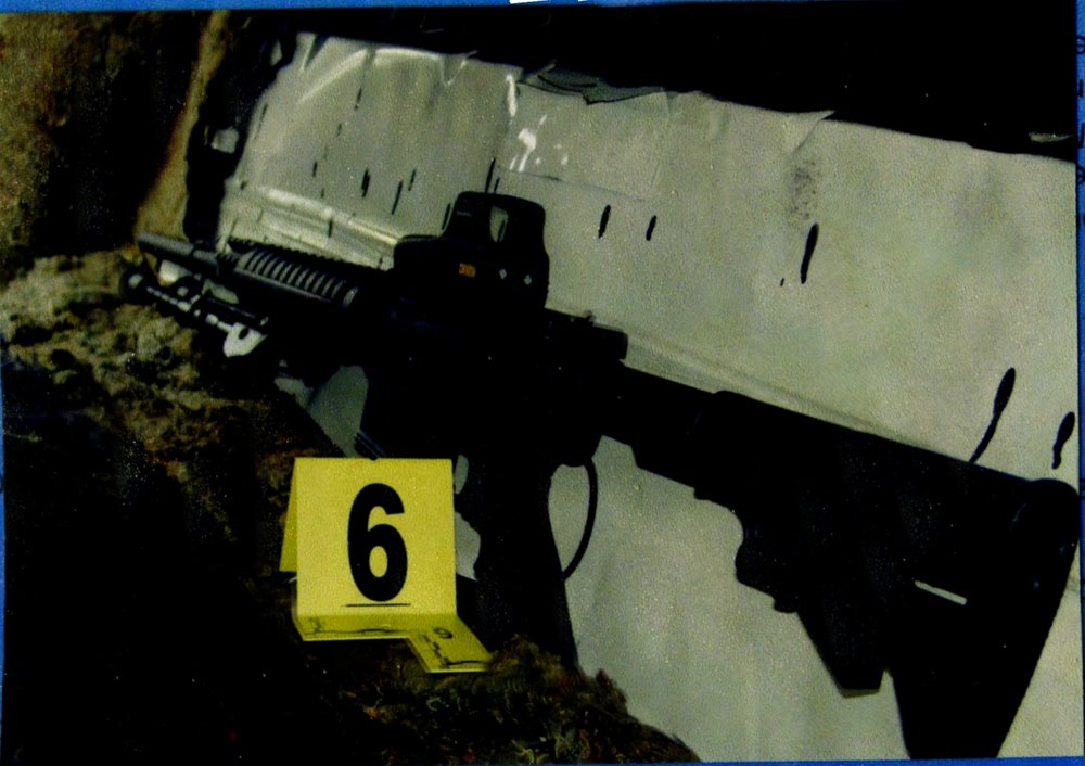 SCAN0007rifle in car (1).jpg