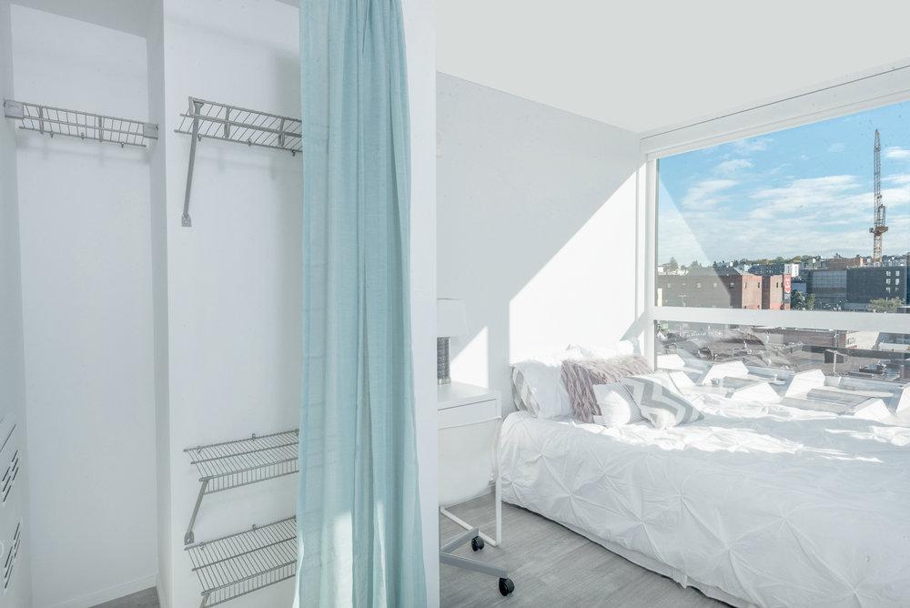 Closet at Pike flats with a teal drape