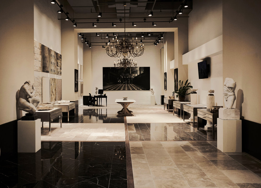 Figurines and statuettes on display at Lapicida, an international luxury natural stone and tile showroom with MEP designed by 2L Engineering, based in New York.