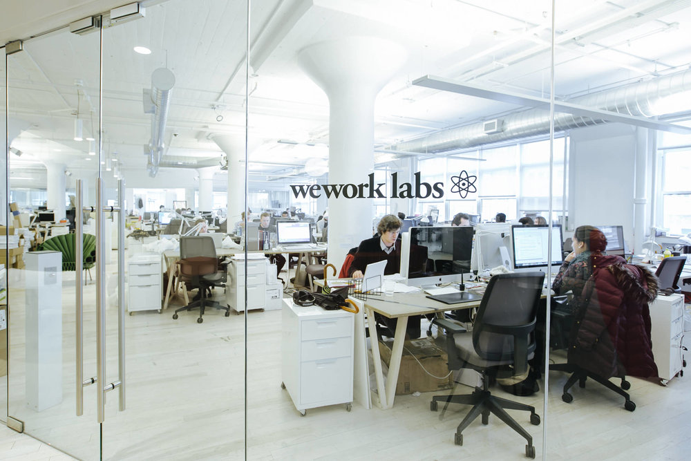 People working in the WeWork Labs at WeWork Varrick Street, New York. MEP designed by 2LS Consulting Engineering.