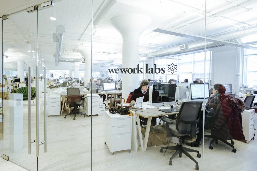 People working in the WeWork Labs at WeWork Varrick Street, New York. MEP designed by 2L Engineering.