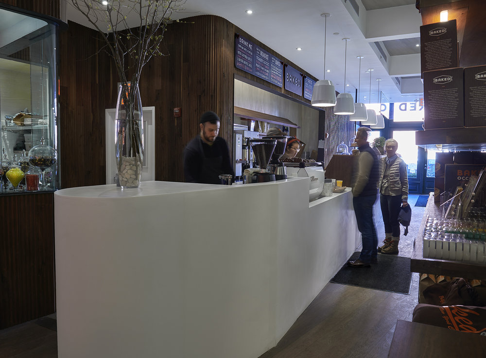 Customers ordering food at the checkout area of Baked Tribeca, a project with MEP provided by 2LS Consulting Engineering, a New York based firm.