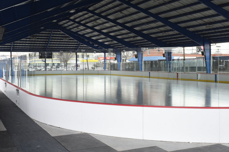 An empty outdoor ice rink with a roof during the daytime in Secaucus New Jersey. Secaucus Ice Skating Rink MEP designed by 2LS Consulting Engineering.