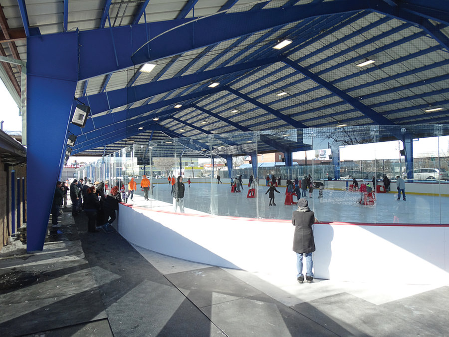 People watching other people ice skating on a sunny winter day at the Secaucus Ice Skating Rink in New Jersey. MEP provided by 2LS Consulting Engineering.